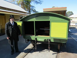 Undertaker with hearse tram